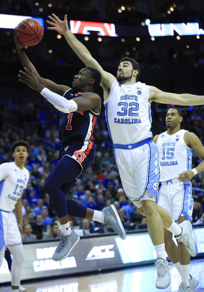 Auburn's Jared Harper (1) heads to the basket past North Carolina's Luke Maye (32) during the first half of a men's NCAA tournament college basketball Midwest Regional semifinal game Friday, March 29, 2019, in Kansas City, Mo. (AP Photo/Orlin Wagner)