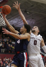 Gonzaga guard Ryan Woolridge, left, shoots against Santa Clara forward DJ Mitchell (0) during the second half of an NCAA college basketball game in Santa Clara, Calif., Thursday, Jan. 30, 2020. (AP Photo/Jeff Chiu)