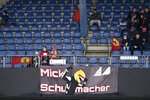 A banner hangs from the stands supporting German driver Mick Schumacher of the Ferrari Driver Academy who will be testing an Alfa Romeo car during the first practice session for the Eifel Formula One Grand Prix at the Nuerburgring racetrack in Nuerburg, Germany, Friday, Oct. 9, 2020. The Germany F1 Grand Prix will be held on Sunday. (Ina Fassbender, Pool via AP)