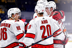Carolina Hurricanes right wing Andrei Svechnikov (37) celebrates his goal against the Nashville Predators with teammates during the second period of an NHL hockey game in Nashville, Tenn., Monday, Jan. 18, 2021. (Andrew Nelles/The Tennessean via AP)
