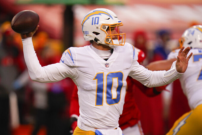 Los Angeles Chargers quarterback Justin Herbert throws a pass during the first half of an NFL football game against the Kansas City Chiefs, Sunday, Jan. 3, 2021, in Kansas City. (AP Photo/Jeff Roberson)