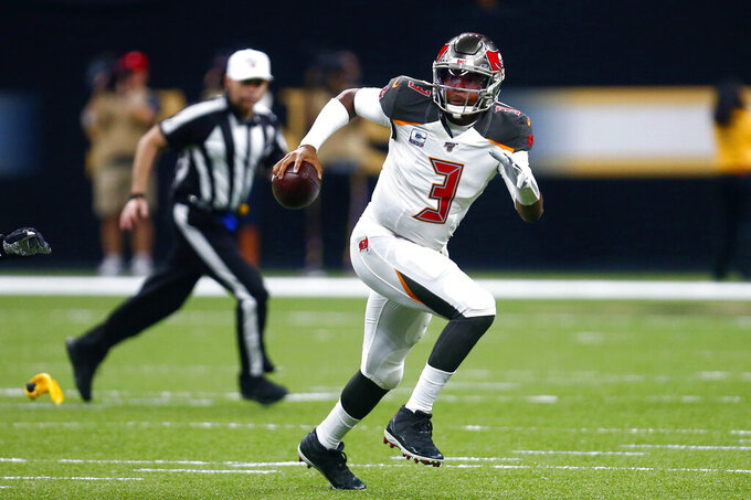 Tampa Bay Buccaneers quarterback Jameis Winston (3) scrambles under pressure in the first half of an NFL football game against the New Orleans Saints in New Orleans, Sunday, Oct. 6, 2019. (AP Photo/Butch Dill)