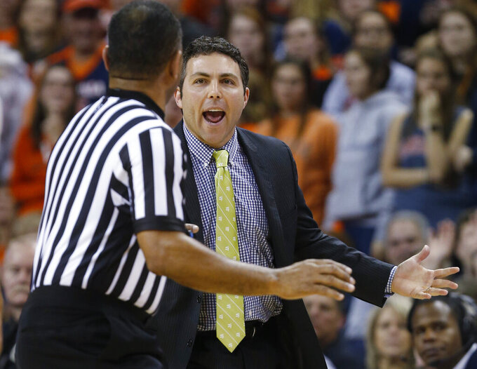 Georgia Tech coach Josh Pastner argues with a referee during the first half of the team's NCAA college basketball game against Virginia in Charlottesville, Va., Wednesday, Feb. 27, 2019. (AP Photo/Steve Helber)
