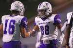 Abilene Christian quarterback Stone Earle (16) and wide receiver Kobe Clark (88) celebrate a touchdown during an NCAA college football game against VirginiaSaturday, Nov. 21, 2020, in Charlottesville, Va. (Erin Edgerton/The Daily Progress via AP)