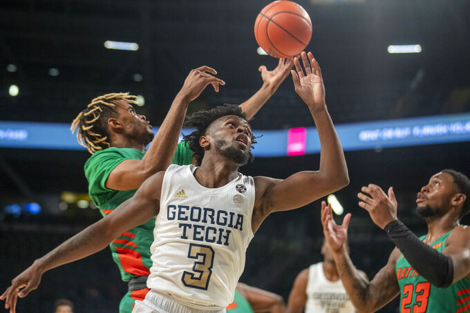 Georgia Tech guard Bubba Parham (3) misses a rebound against Florida A&M during the first half of an NCAA college basketball game in Atlanta, Friday, Dec. 18, 2020. (Alyssa Pointer/Atlanta Journal-Constitution via AP)
