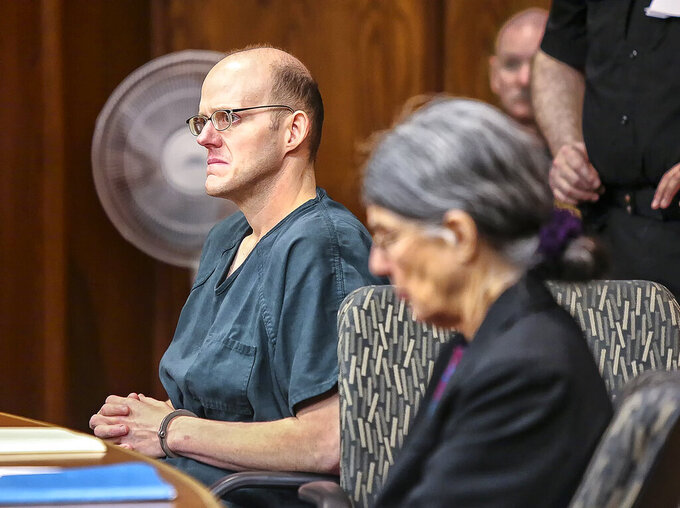 Timothy Haag listens as his attorney gives her opening remarks at the start of his resentencing proceedings in Cowlitz County Superior Court in Longview, Wash., on Jan. 12, 2018. The Washington State Supreme Court on Thursday, Sept. 23, 2021, overturned a 46-year sentence for Haag who killed his friend's little sister when he was 17, finding the punishment focused more on retribution than rehabilitation. Haag, of Longview, was initially sentenced to life without parole for choking and drowning 7-year-old Rachel Dillard in a bathtub in 1994. (Bill Wagner/The Daily News via AP)