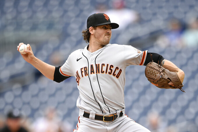 San Francisco Giants starting pitcher Kevin Gausman delivers a pitch during the first inning of the first baseball game of a doubleheader against the Washington Nationals, Saturday, June 12, 2021, in Washington. This game is a makeup of a postponed game from Thursday. (AP Photo/Nick Wass)