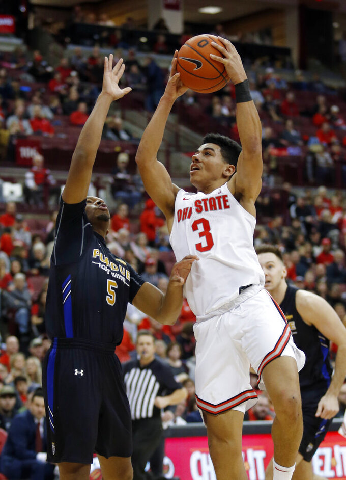 Ohio State guard D.J. Carton, right, goes up for a shot in front of Purdue Fort Wayne guard Tionne Rollins during the second half of an NCAA college basketball game in Columbus, Ohio, Friday, Nov. 22, 2019. Ohio State won 85-46 (AP Photo/Paul Vernon)
