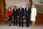 Norway's King Harald, Queen Sonja, left, Crown Prince Haakon, second right, and Crown Princess Mette-Marit poses for the media with 2019 Nobel Peace Prize Laureate Abiy Ahmed in the Royal Palace in Oslo, Tuesday Dec. 10, 2019, ahead of the award ceremony. (Terje Pedersen/NTB Scanpix via AP)