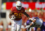 Iowa State running back Breece Hall (28) runs the ball as he eludes a tackle by Northern Iowa defensive back Jevon Brekke (0) during the first half of an NCAA college football game, Saturday, Sept. 4, 2021, in Ames, Iowa. (AP Photo/Matthew Putney)