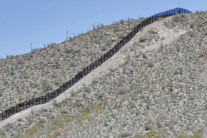 A rugged uphill section of the international border wall that runs through Organ Pipe National Monument is shown, Thursday, Aug. 22, 2019 in Lukeville, Ariz. Construction on a two mile portion of replacement fencing funded by President Trump's national emergency declaration has begun in an area near the official border crossing that runs through Organ Pipe. (AP Photo/Matt York)