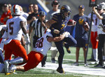 California quarterback Chase Garbers (7) is tackled by Idaho State's Kody Graves (38) during the first half of an NCAA college football game Saturday, Sept. 15, 2018, in Berkeley, Calif. (AP Photo/Ben Margot)