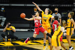 Ohio State guard Madison Greene (0) drives to the basket past Iowa guard McKenna Warnock (14) during the first half of an NCAA college basketball game, Wednesday, Jan. 13, 2021, in Iowa City, Iowa. (AP Photo/Charlie Neibergall)