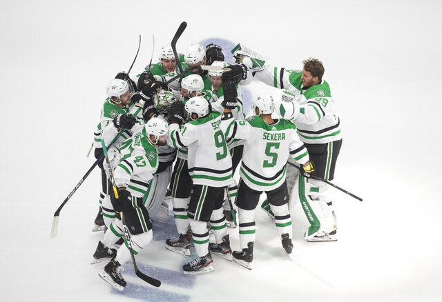 Dallas Stars players celebrate their overtime win over the Vegas Golden Knights in the NHL Western Conference final playoff game action in Edmonton, Alberta, Monday, Sept. 14, 2020. (Jason Franson/The Canadian Press via AP)