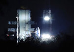 In this Monday, July 15, 2019, file photo, Indian Space Research Organization (ISRO)'s Geosynchronous Satellite launch Vehicle (GSLV) MkIII carrying Chandrayaan-2 stands at Satish Dhawan Space Center after the mission was aborted at the last minute at Sriharikota, in southern India. India has called off the launch of a moon mission to explore the lunar south pole. The Chandrayaan-2 mission was aborted less than an hour before takeoff on Monday. An Indian Space Research Organization spokesman says a
