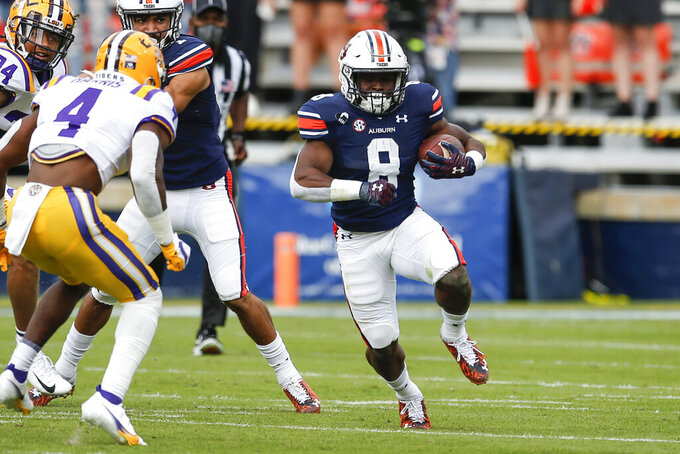 Auburn running back Shaun Shivers (8) carries the ball during the first quarter of an NCAA college football game against LSU, Saturday, Oct. 31, 2020, in Auburn, Ala. (AP Photo/Butch Dill)