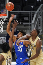 Kentucky forward Olivier Sarr (30) battled Georgia Tech forward Moses Wright (5) for a rebound during the first half of an NCAA college basketball game Sunday, Dec. 6, 2020, in Atlanta. (AP Photo/John Bazemore)