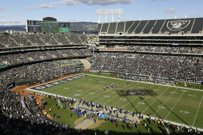 The Oakland Raiders run a play against the Jacksonville Jaguars during the first half of an NFL football game in Oakland, Calif., Sunday, Dec. 15, 2019. The game is the final scheduled Raiders game in Oakland. (AP Photo/Eric Risberg)