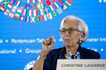 Managing Director of International Monetary Fund (IMF) Christine Lagarde talks during a press conference ahead of the annual meetings of the IMF and World Bank  in Bali, Indonesia on Thursday, Oct. 11, 2018. (AP Photo/Firdia Lisnawati)