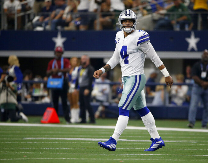 Dallas Cowboys quarterback Dak Prescott (4) walks off the field after throwing an interception caught by Green Bay Packers' Chandon Sullivan in the first half of an NFL football game in Arlington, Texas, Sunday, Oct. 6, 2019. (AP Photo/Ron Jenkins)