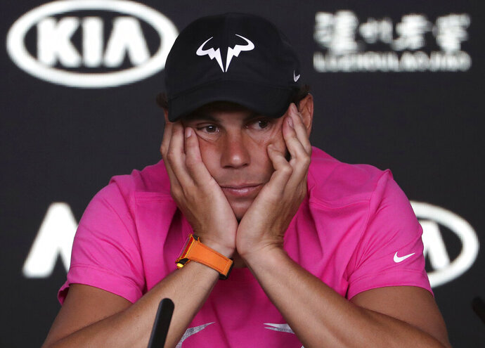 Spain's Rafael Nadal reacts during a press conference ahead of the Australian Open tennis championships in Melbourne, Australia, Saturday, Jan. 12, 2019. (AP Photo/Mark Schiefelbein)