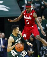 Michigan State forward Kenny Goins (25) looks to drive around Nebraska guard Glynn Watson Jr. (5) during the first half of an NCAA college basketball game, Tuesday, March 5, 2019, in East Lansing, Mich. (AP Photo/Carlos Osorio)