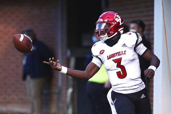 Louisville quarterback Malik Cunningham (3) scores a touchdown against Virginia during an NCAA college football game Saturday, Nov. 14, 2020, in Charlottesville, Va. (Erin Edgerton/The Daily Progress via AP)