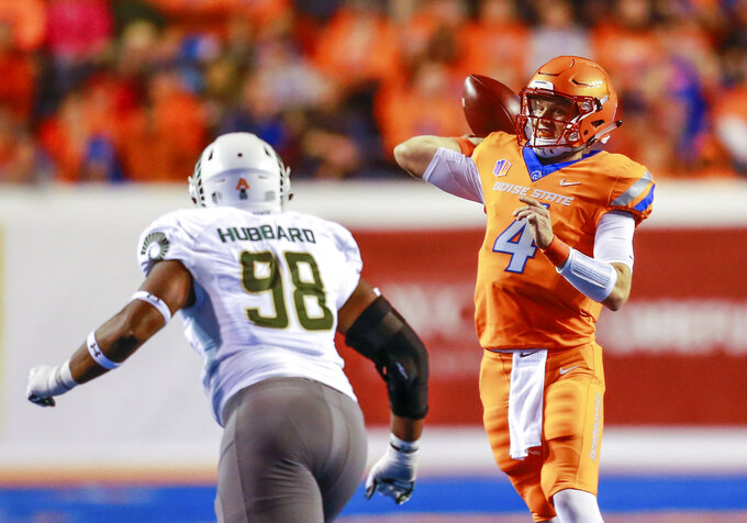 Boise State quarterback Brett Rypien (4) looks to throw downfield as Colorado State defensive lineman Ellison Hubbard (98) pressures him in the first half of an NCAA college football game, Friday, Oct. 19, 2018, in Boise, Idaho. (AP Photo/Steve Conner)