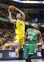 Indiana Pacers forward Bojan Bogdanovic (44) shoots over Boston Celtics center Al Horford (42) during the second half of Game 4 of an NBA basketball first-round playoff series in Indianapolis, Sunday, April 21, 2019. The Celtics defeated the Pacers 110-106 to win the series 4-0. (AP Photo/Michael Conroy)