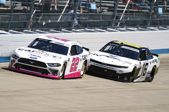Austin Cindric, left, competes with AJ Allmendinger, right, during a NASCAR Xfinity Series auto race at Dover International Speedway, Tuesday, June 15, 2021, in Dover, Del. Cindric won the race. (AP Photo/Chris Szagola)