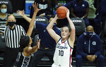Connecticut guard Nika Muhl (10) looks to pass against Georgetown forward Jillian Archer (14) in the first half of an NCAA college basketball game Saturday, Jan. 23, 2021, in Storrs, Conn. (David Butler II/Pool Photo via AP)