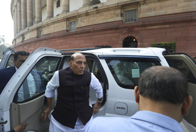 FILE-In this Feb. 11, 2020 file photo, Indian Defense Minister Rajnath Singh arrives at Parliament House in New Delhi, India. Singh accused China on Tuesday of violating past border agreements and expanding its troop deployment along a disputed mountainous frontier in Ladakh where the two countries have been locked in a military standoff for months. (AP Photo/Manish Swarup, File)