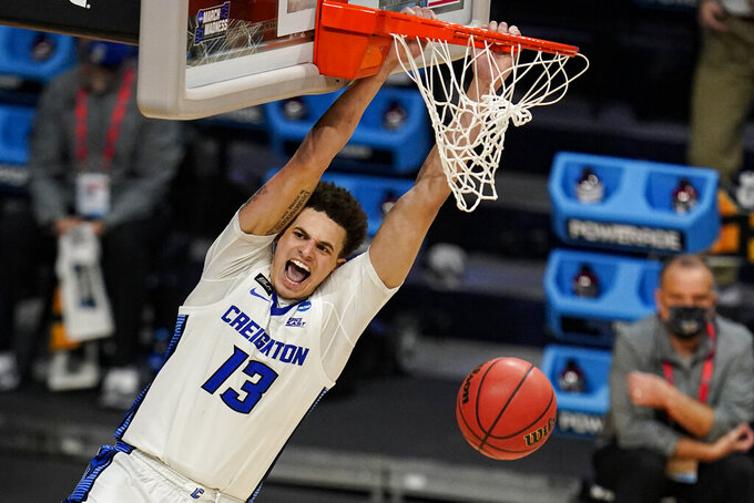 Creighton forward Christian Bishop (13) follows through on a dunk against Ohio in the second half of a second-round game in the NCAA men's college basketball tournament at Hinkle Fieldhouse in Indianapolis, Monday, March 22, 2021. (AP Photo/Michael Conroy)