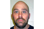 FILE - This this March 2021, file photo provided by the Nevada Department of Corrections shows convicted murderer Zane Michael Floyd, 45, an inmate at Ely State Prison. A day after Gov. Steve Sisolak and the top Democrat in the Legislature declared efforts to repeal the state's death penalty law dead, Clark County District Court Judge Michael Villani on Monday, May 10, 2021, pushed back to June 4 a hearing on the district attorney's request to set a late July date for the lethal injection of Zane Michael Floyd. Floyd, now 45, would be the first convicted killer put to death in Nevada since 2006.  (Nevada Department of Corrections via AP)