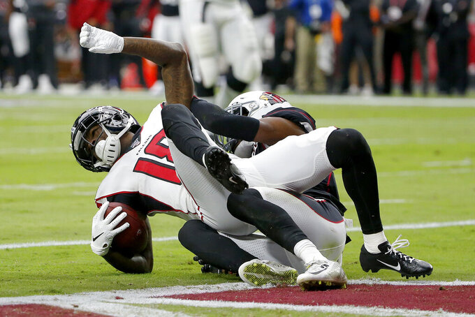 Atlanta Falcons wide receiver Calvin Ridley, left, scores a touchdown as Arizona Cardinals defensive back Jalen Thompson defends during the first half of an NFL football game, Sunday, Oct. 13, 2019, in Glendale, Ariz. (AP Photo/Rick Scuteri)