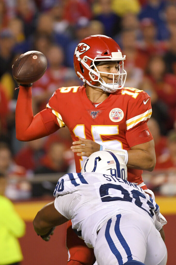 Indianapolis Colts defensive tackle Grover Stewart (90) sacks Kansas City Chiefs quarterback Patrick Mahomes (15) during the second half of an NFL football game in Kansas City, Mo., Sunday, Oct. 6, 2019. (AP Photo/Reed Hoffmann)