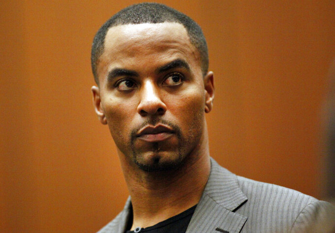 FILE - In this Feb. 20, 2014, file photo, former NFL safety Darren Sharper appears in Los Angeles Superior Court in Los Angeles. Disgraced NFL star Darren Sharper's attempt to get out of a 2016 plea deal and the resulting 18-year prison sentence in a sexual assault case has been rejected by a federal judge. Attorneys for Sharper argued in a motion filed last year that he was not adequately advised by his previous lawyers on the consequences of his 2016 guilty plea, which arose from allegations that Sharper drugged and sexually assaulted as many as 16 women in four states. (Bob Chamberlin/Los Angeles Times via AP, Pool, File)