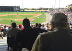 FILE - In this March 5, 2016, file photo, Tommy Giordano, right foreground, special assistant to the general manager of the Atlanta Braves, scouts a spring training baseball game between the Braves and the Pittsburgh Pirates, in Kissimmee, Fla. Tommy Giordano is dying. But do not let your heart be heavy. He's going out like he lived for more than 93 years _ surrounded by family and friends, accompanied by overwhelming love and stories that will endure long after he's gone. (AP Photo/Paul Newberry, File)