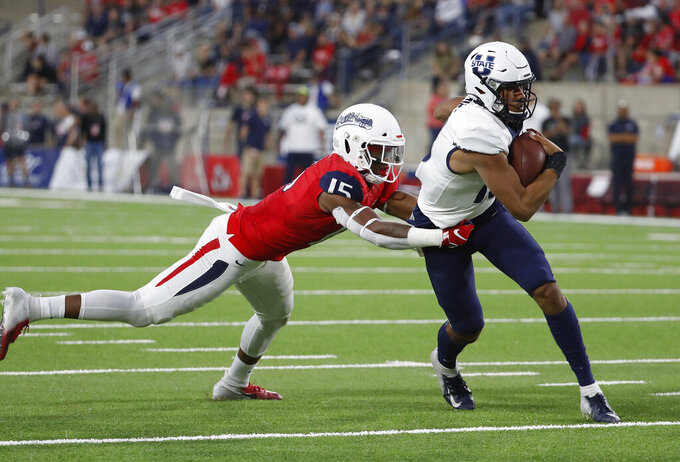 Utah State quaterback Jordan Love tries to avoid Fresno State linebacker Arron Mosby during the first half of an NCAA college football game in Fresno, Calif., Saturday, Nov. 9, 2019. (AP Photo/Gary Kazanjian)
