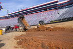 FILE - Workers turn Bristol Motor Speedway into a dirt track, in Bristol, Tenn., in this Thursday, Jan. 14, 2021, file photo. Bristol, once one of the toughest tickets in sports, trucked 23,000 cubic yards of dirt into its famed bullring to transform the facility and host NASCAR's first Cup race on dirt in 70 years on Sunday, March 28.  (David Crigger/Bristol Herald Courier via AP, FIle)\