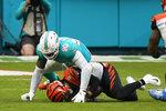 Miami Dolphins outside linebacker Shaq Lawson (90) sacks Cincinnati Bengals quarterback Brandon Allen (8) during the second half of an NFL football game, Sunday, Dec. 6, 2020, in Miami Gardens, Fla. (AP Photo/Wilfredo Lee)