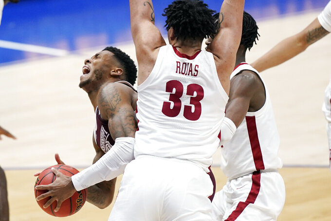 Mississippi State's D.J. Stewart Jr., left, is pressured by Alabama's James Rojas (33) in the second half of an NCAA college basketball game in the Southeastern Conference Tournament Friday, March 12, 2021, in Nashville, Tenn. (AP Photo/Mark Humphrey)
