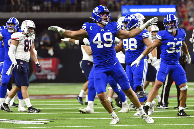 BYU linebacker Payton Wilgar (49) reacts after a missed field goal by Arizona during the second half of an NCAA college football game Saturday, Sept. 4, 2021, in Las Vegas. (AP Photo/David Becker)