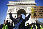 Yellow vest protesters gather at the Arc de Triomphe, Saturday, Feb.16, 2019 in Paris. Yellow vests protesters keep pressure on French President Emmanuel Macron's government, for the 14th straight weekend of demonstrations. (AP Photo/Thibault Camus)