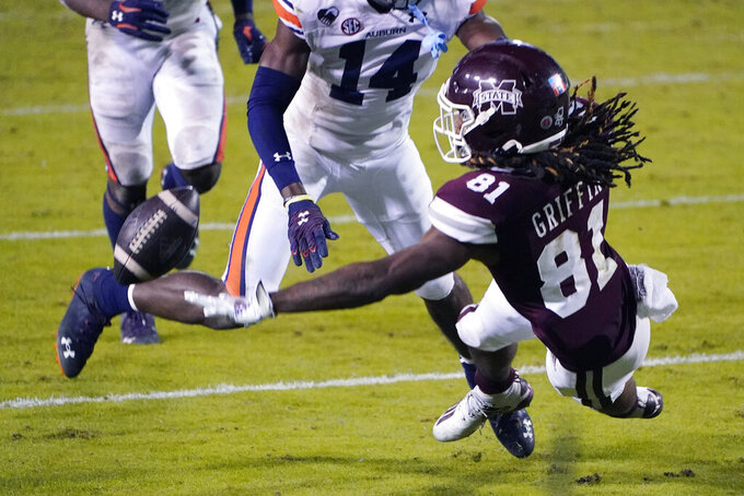 Mississippi State wide receiver Lideatrick Griffin (81) reaches for an incomplete pass while covered by Auburn defensive back Nehemiah Pritchett (14) during the second half of an NCAA college football game Saturday, Dec. 12, 2020, in Starkville, Miss. (AP Photo/Rogelio V. Solis)