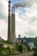 FILE—In this file photo from June 10, 2021, a flume of emissions flow from a stack at the Cheswick Generating Station, a coal-fired power plant, in Springdale, Pa. A plan to impose a price on carbon dioxide emissions from fossil fuel-fired power plants in Pennsylvania is going before the Independent Regulatory Review Commission, a five-member panel made up of three Democratic appointees and two Republican appointees on Wednesday, Sept. 1, 2021. (AP Photo/Keith Srakocic, File)