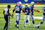 Indianapolis Colts kicker Rodrigo Blankenship (3) celebrates field goal with offensive guard Quenton Nelson (56) against the Baltimore Ravens in the first half of an NFL football game in Indianapolis, Sunday, Nov. 8, 2020. (AP Photo/Darron Cummings)