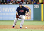 Boston Red Sox first baseman Mitch Moreland fields a single by Texas Rangers' Willie Calhoun in the first inning of a baseball game in Arlington, Texas, Tuesday, Sept. 24, 2019. (AP Photo/Tony Gutierrez)
