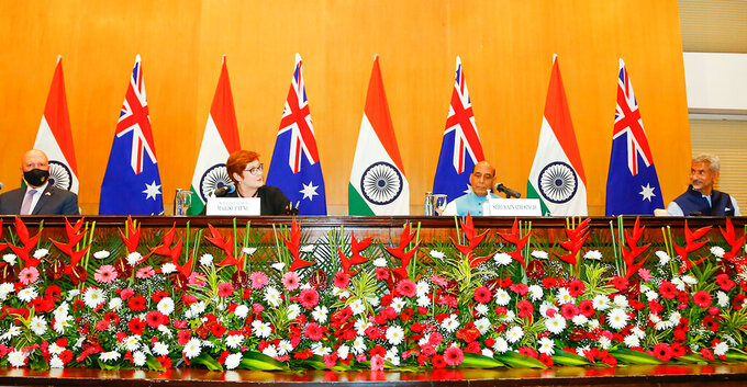 From left, Australian Defense Minister Peter Dutton, Australian Foreign Minister Marise Payne , Indian Defense Minister Rajnath Singh and Indian Foreign Minister S, Jaishankar sit for a meeting in New Delhi, India, Saturday, Sept. 11, 2021. Top ministers from India and Australia on Saturday called for international anti-terror efforts in Afghanistan, bolstering mutual security ties and blunting China's growing regional assertiveness. (Indian Ministry of Defense via AP)