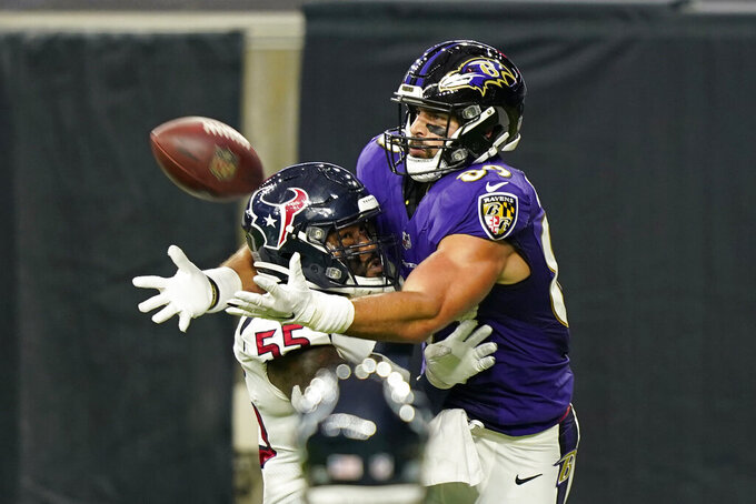 FILE - In this Sept. 20, 2020, file photo, Houston Texans inside linebacker Benardrick McKinney (55) breaks up a pass intended for Baltimore Ravens tight end Mark Andrews (89) during the second half of an NFL football game in Houston. The photo was part of a series of images by photographer David J. Phillip which won the Thomas V. diLustro best portfolio award for 2020 given out by the Associated Press Sports Editors during their annual winter meeting. (AP Photo/David J. Phillip, File)